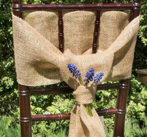 hessian on dark wood chair with lavender Hessian ties