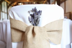 hessian on white chaircover with lavender Hessian ties